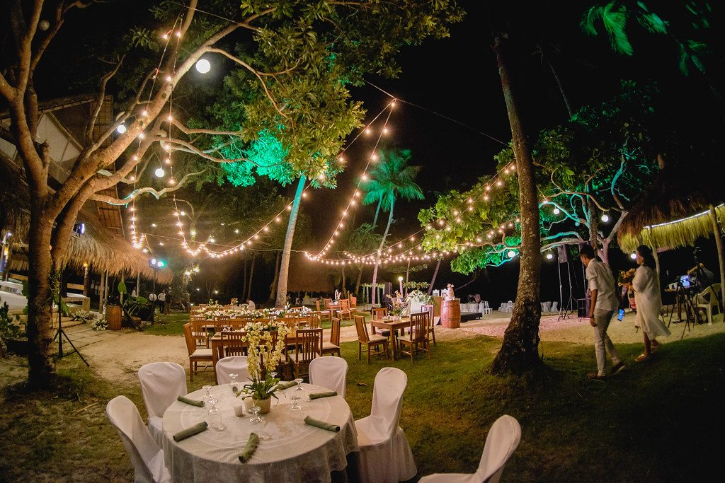 backyard wedding at night with string lighting