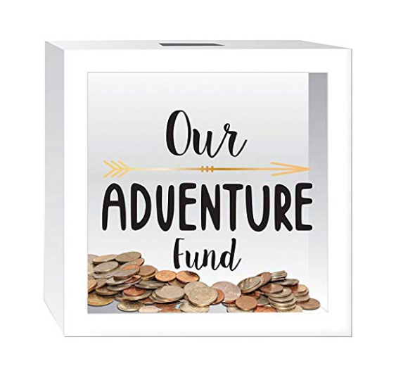 """a white adventure fund box with the text """"Our Adventure Fund"""""""